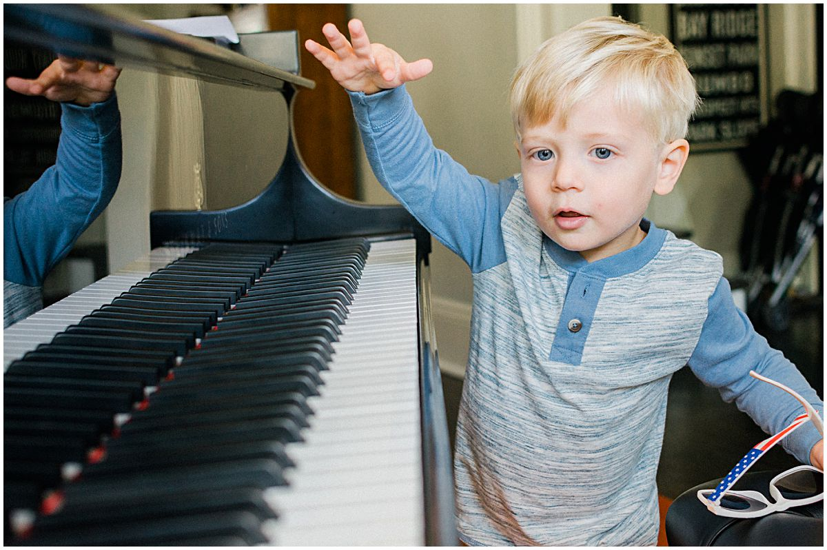 little boy playing piano man at his home in NJ during photo session