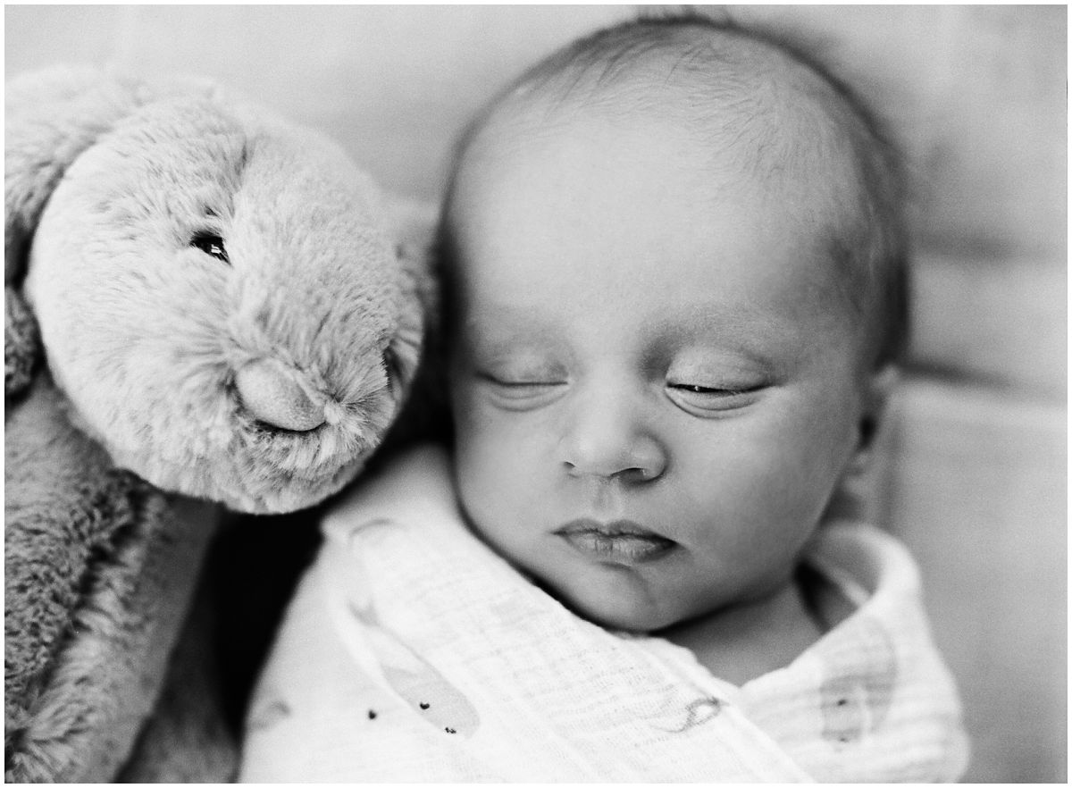 baby boy laying down with his little bunny captured by Newborn Photographer Miriam Dubinsky in Hoboken NJ