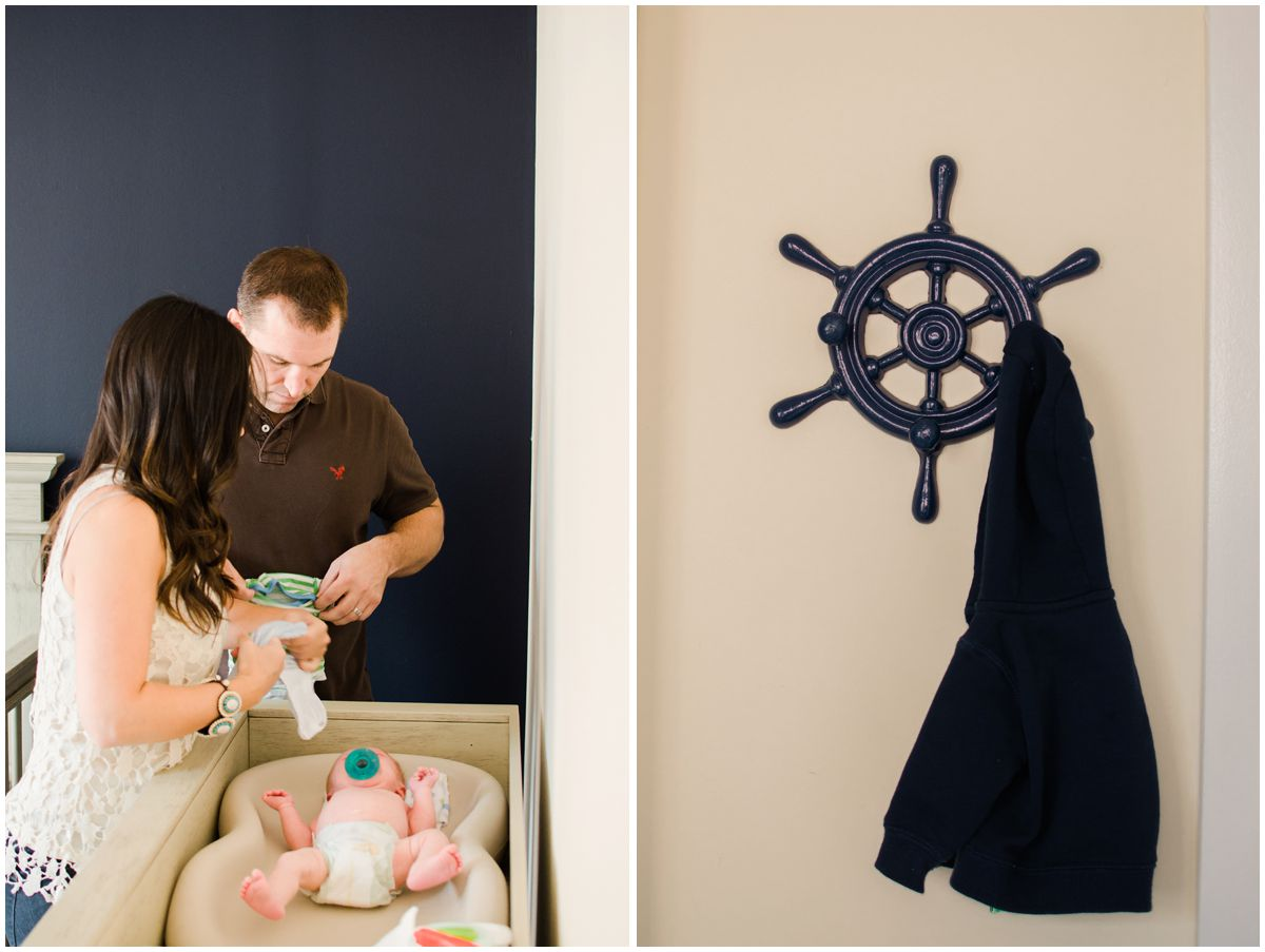 mom and dad changing their baby diaper in the decorative nursery of their Hoboken NJ home