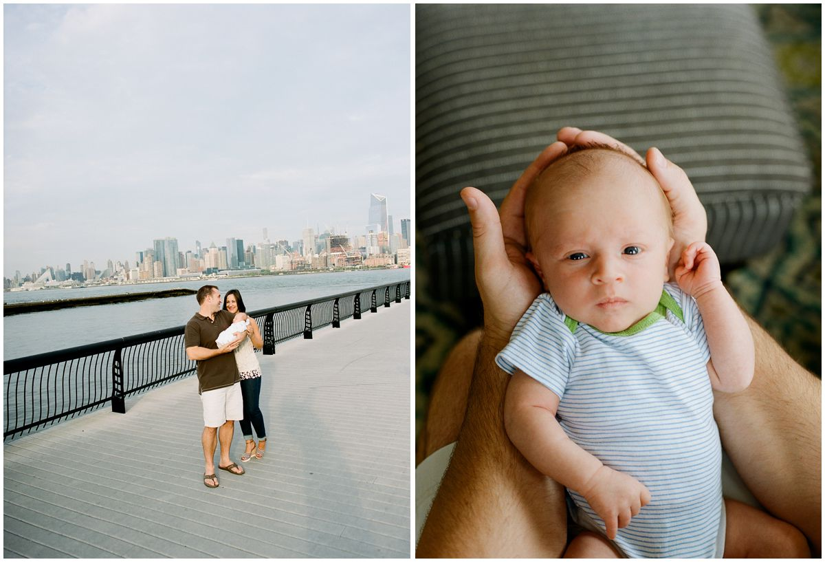 Mom and dad walking by Hoboken Waterfront and holding their newborn baby boy with blue eyes