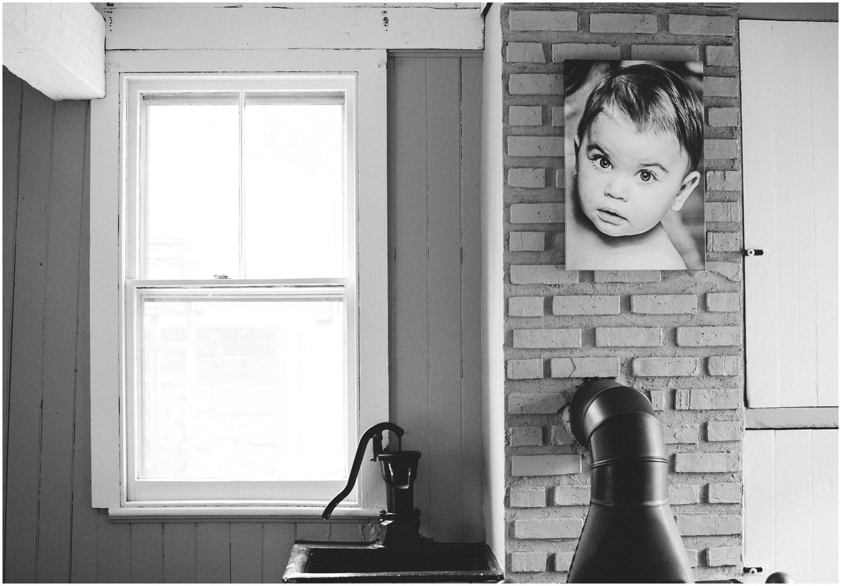 black and white portrait on the wall wow the little sister in Bergen County, NJ home