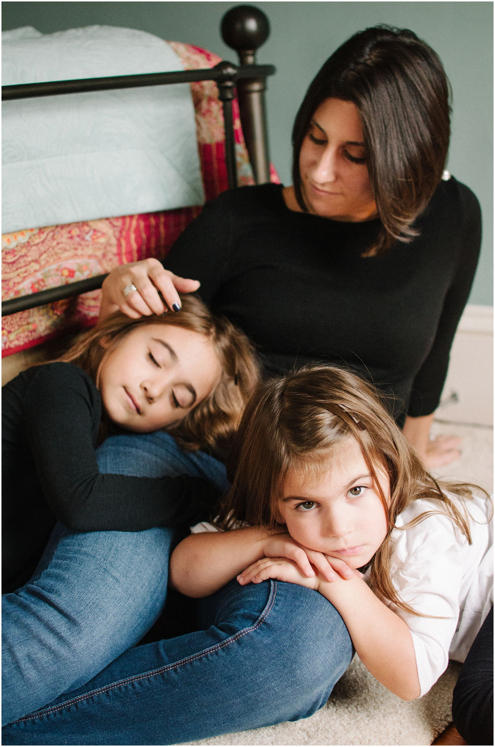 Family Photographer Miriam Dubinsky shares a motherhood portrait of a mom and two daughters snuggling together in their NJ bedroom
