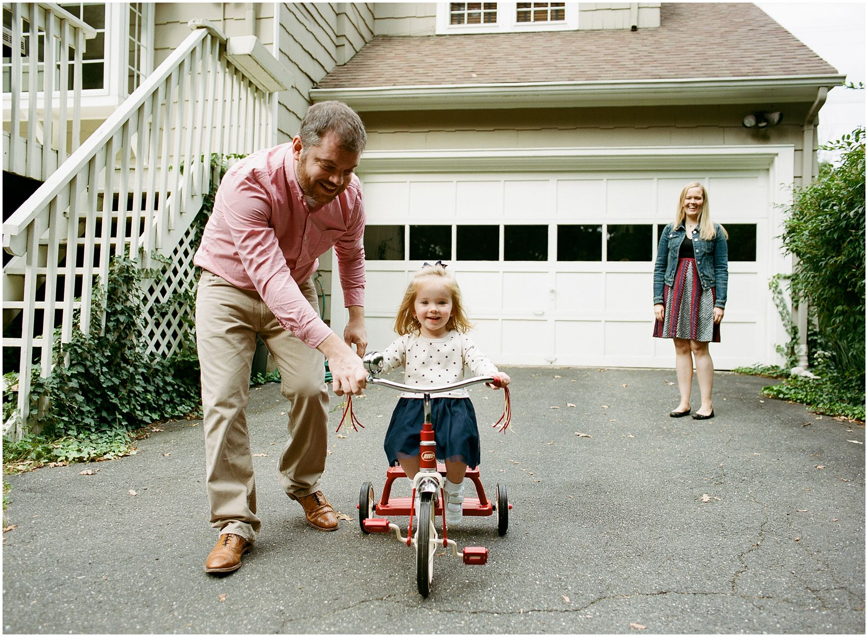 big sister riding bicycle while having  lifestyle family photography