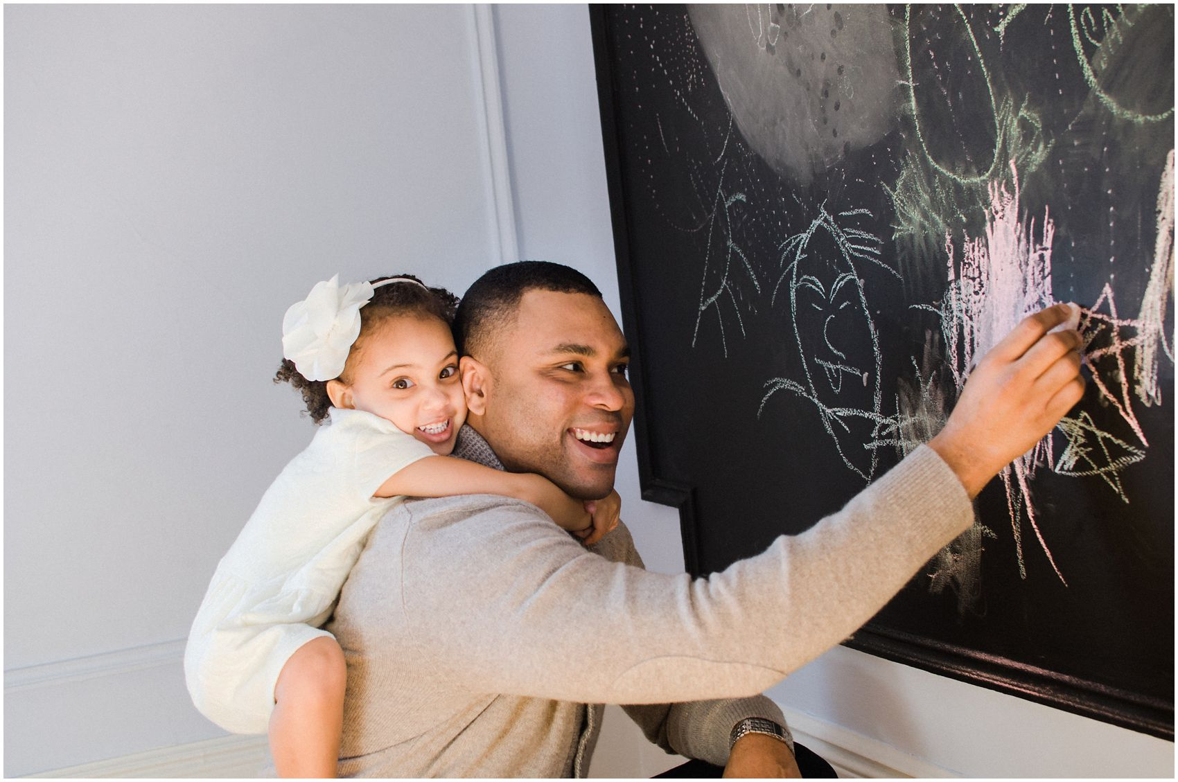at home piggy back ride with daddy and drawing on the chalkboard in Manhattan NY