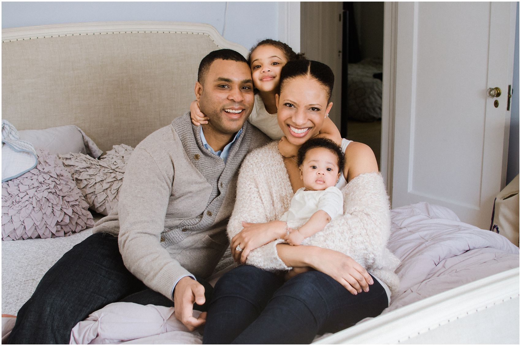 family pictures at home with the newborn girl at home in New York, NY