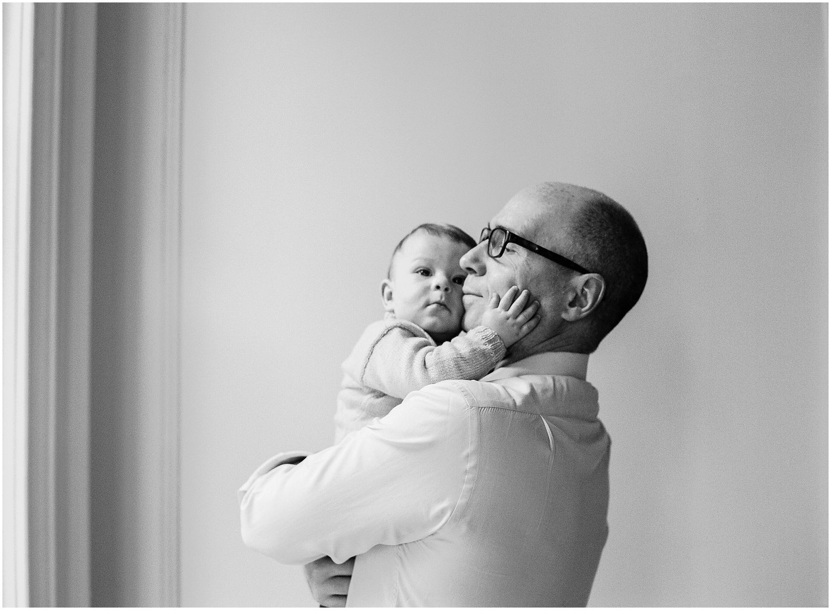 father and the baby hugging lifestyle portrait