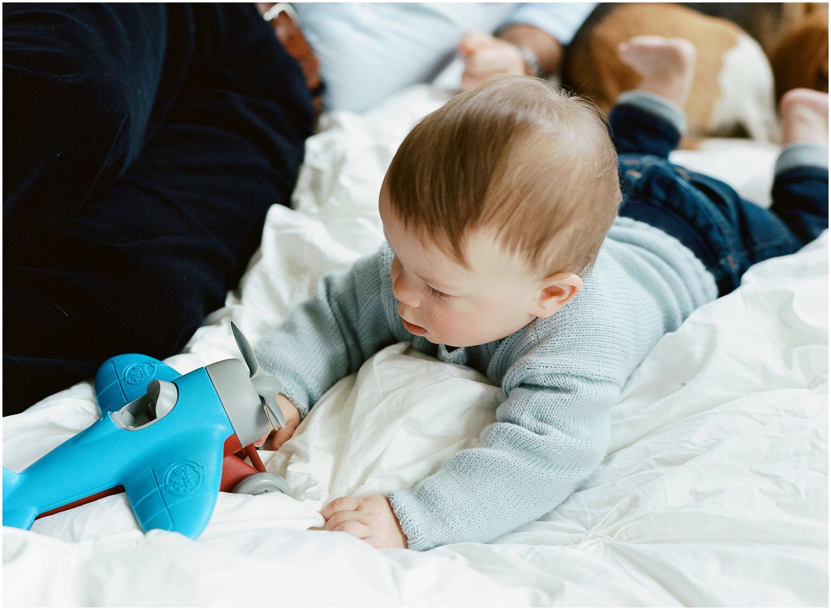 baby with the airplane toy