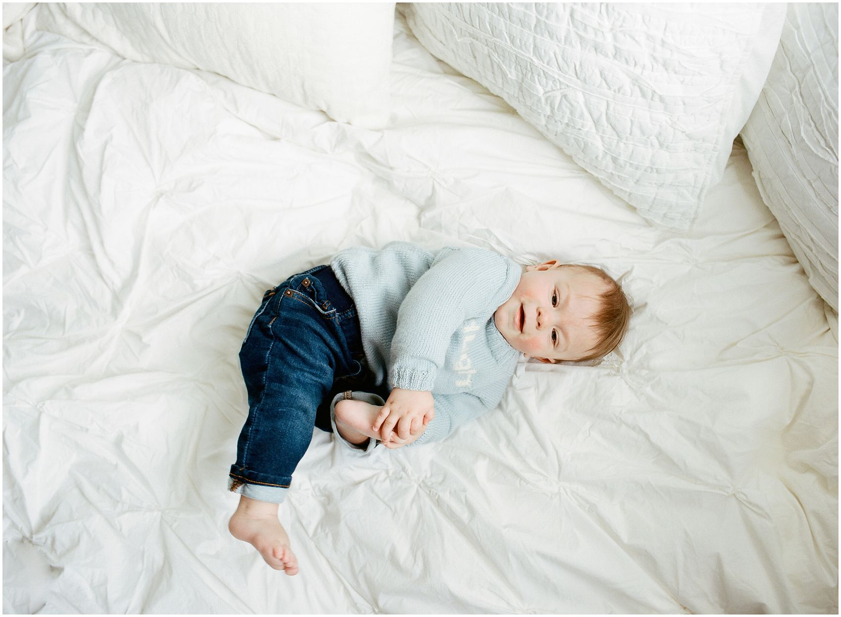 baby boy on the bed during the photo session