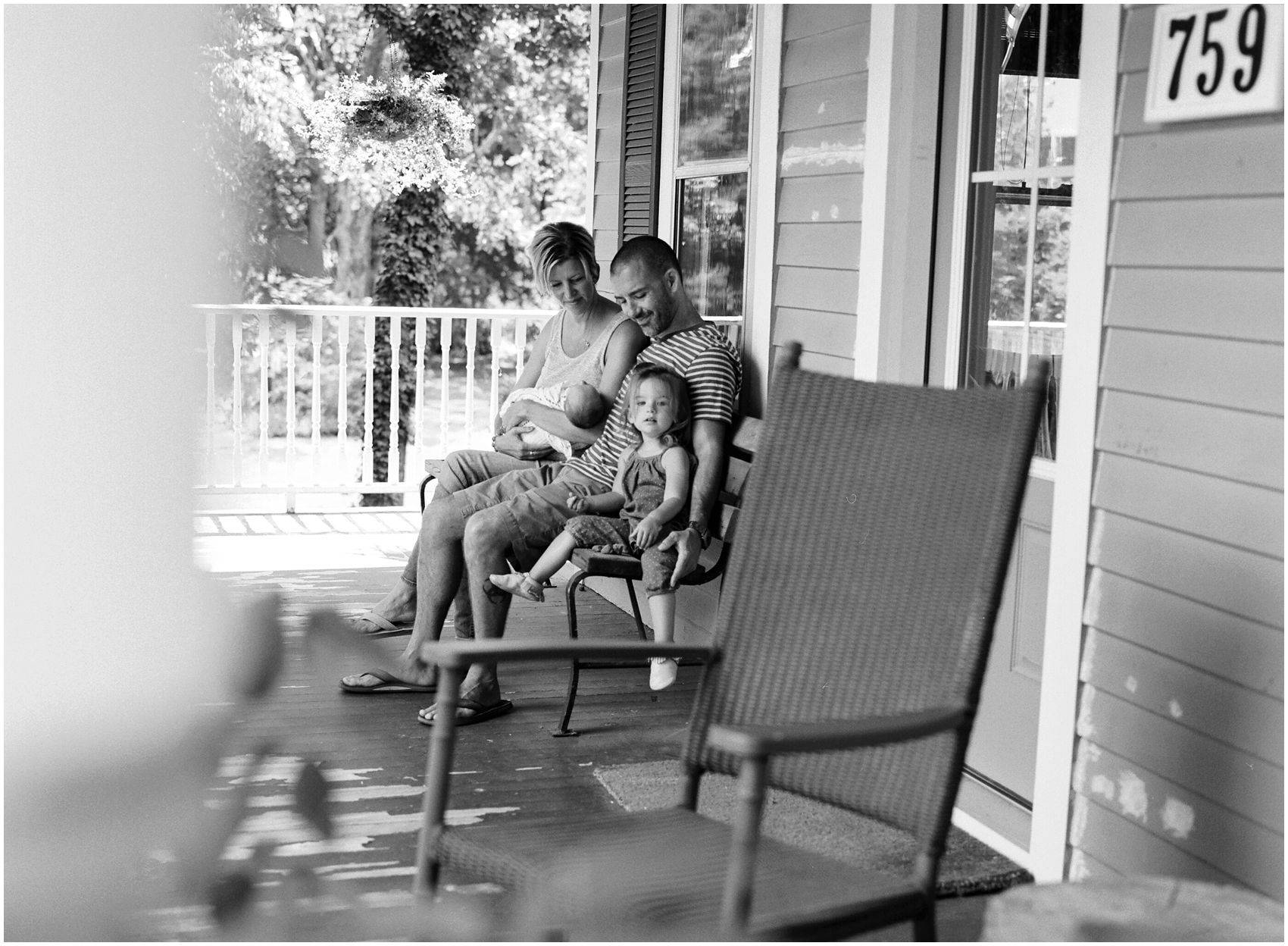 photographer captures the new family on their porch