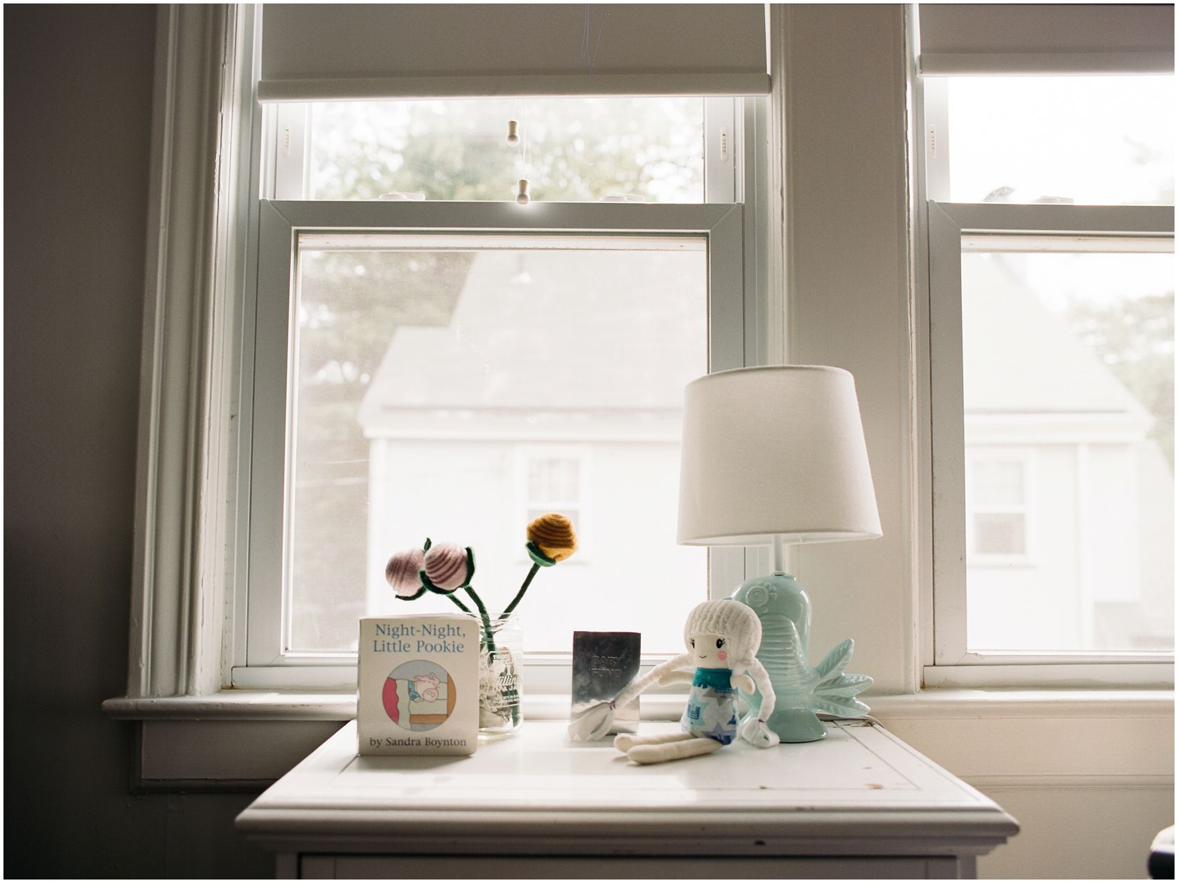 Detailed portrait of a windowsill of a child bedroom with toys and books in Essex County NJ home