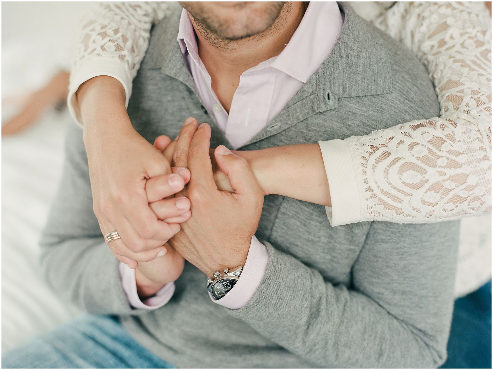 a couple holding hands during engagement photos