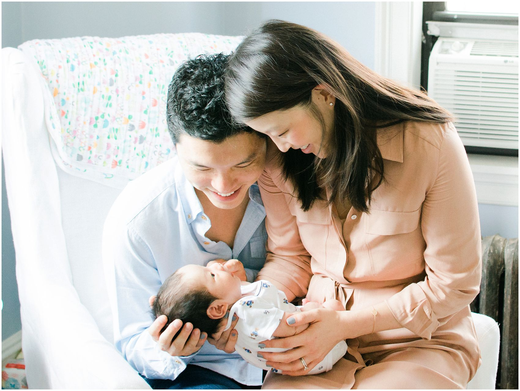 family wearing vintage pink and blue for the newborn photos at their home in New York, NY
