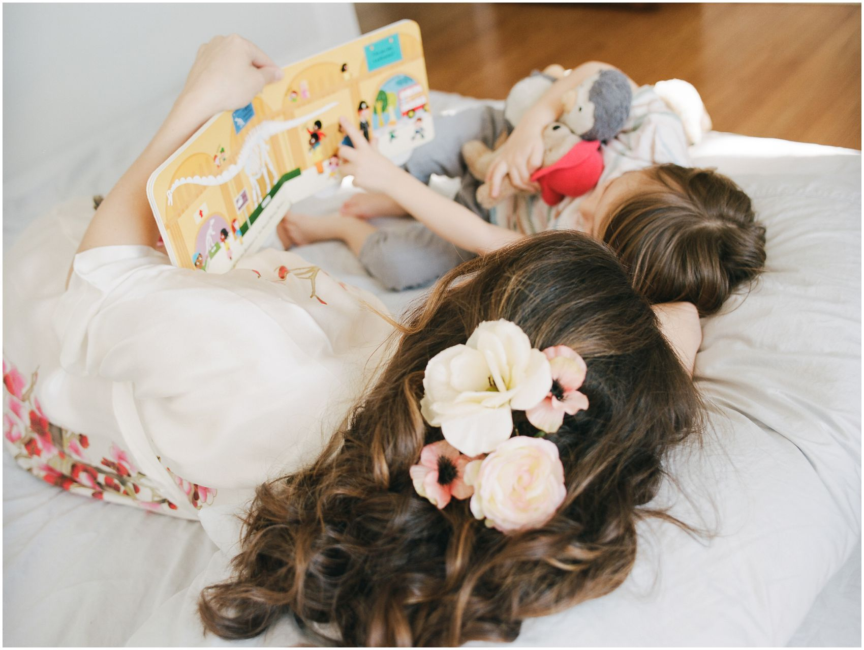 beautiful hair flowers for mom reading a book with her son in bed