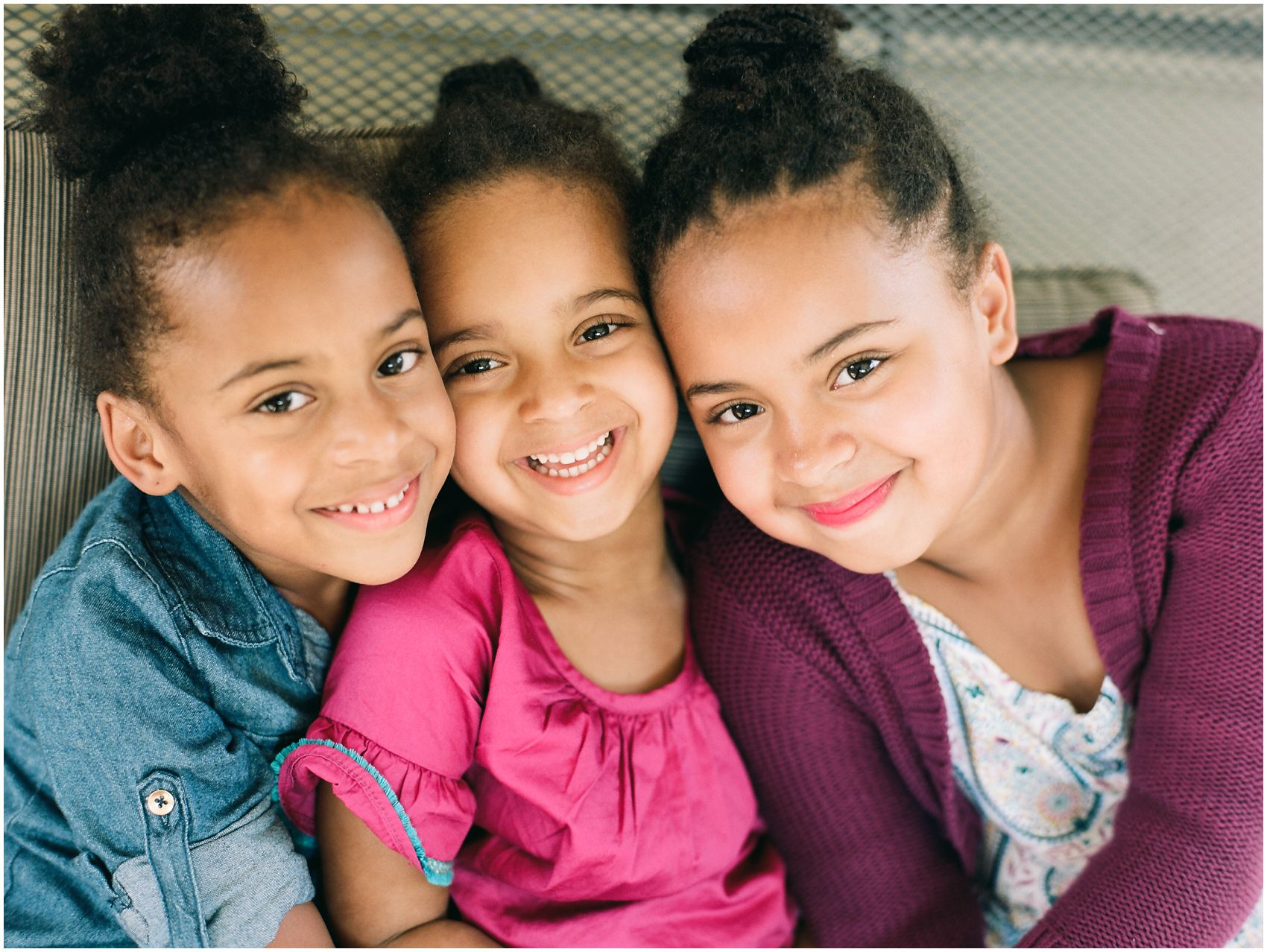 Family session with 3 sisters smiling together in West Orange NJ