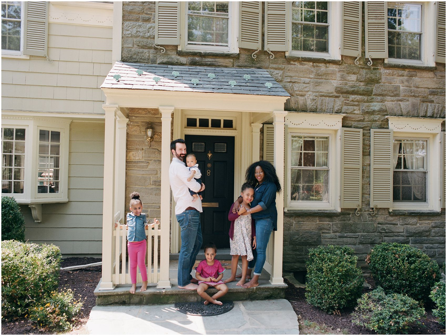 family lifestyle portraits in front of their Maplewood NJ home