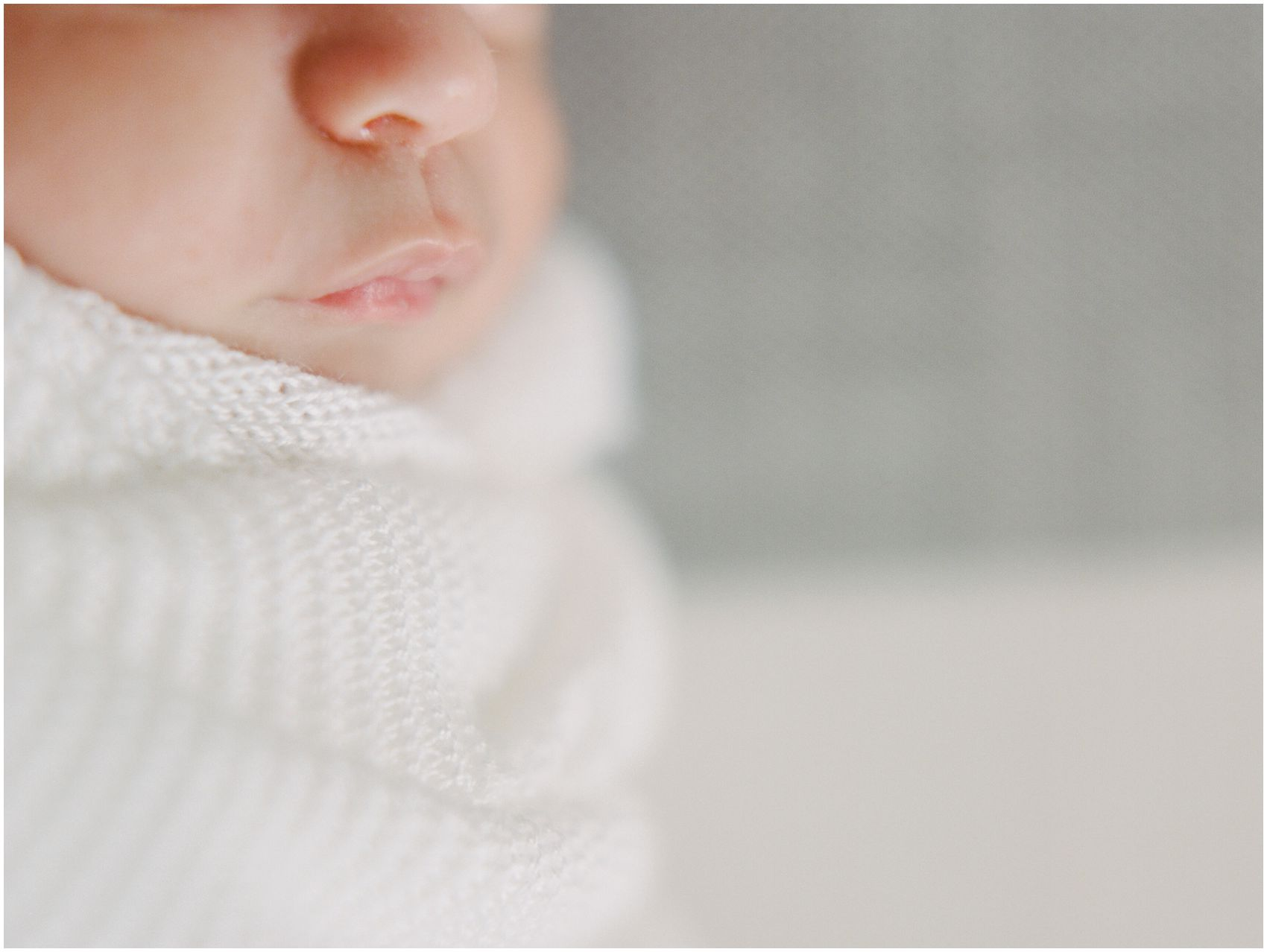 a closeup of baby lips in artistic newborn photos in NYC apartment