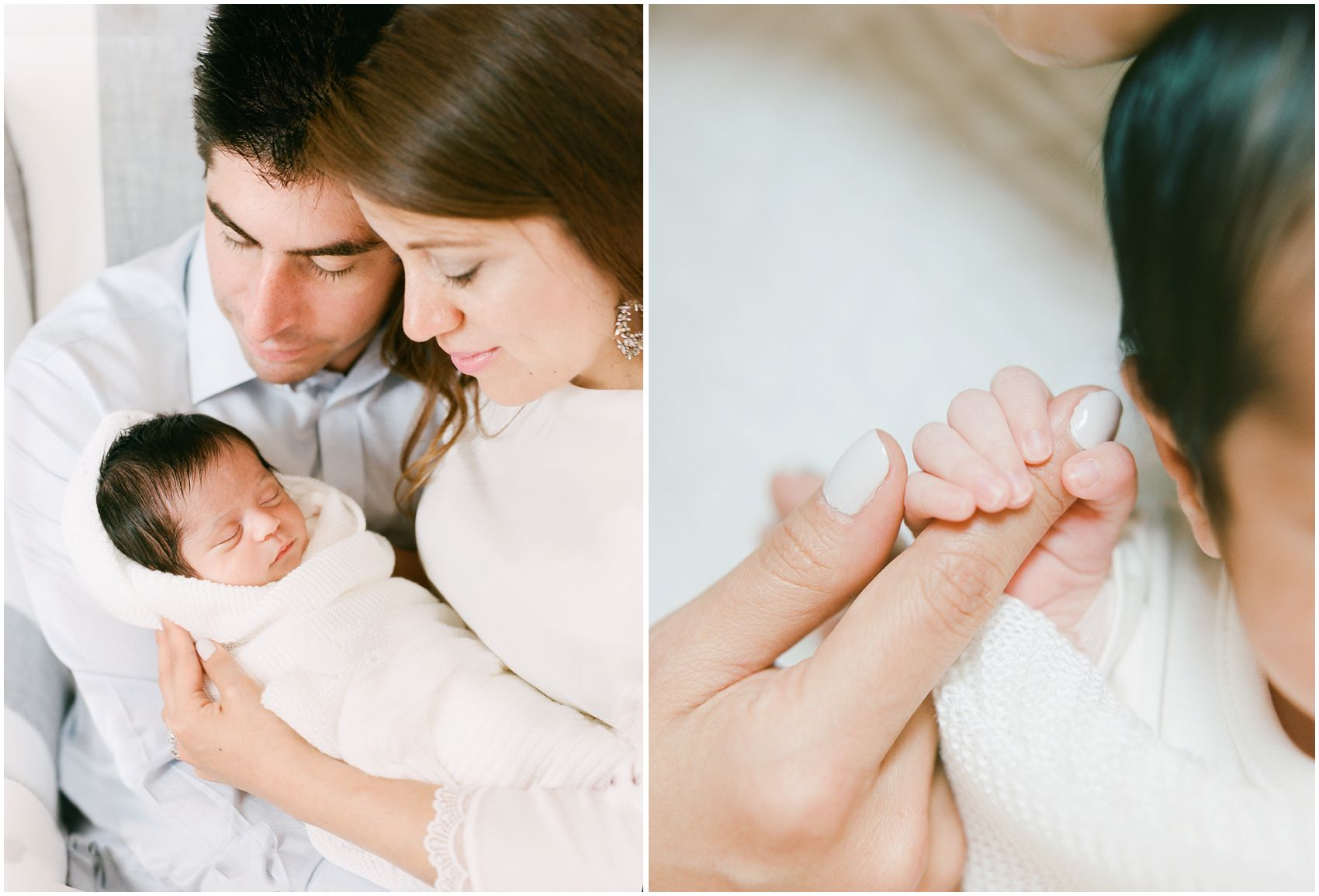 Indoor portrait of parents holding their baby girl in a tight space for NYC newborn lifestyle photos