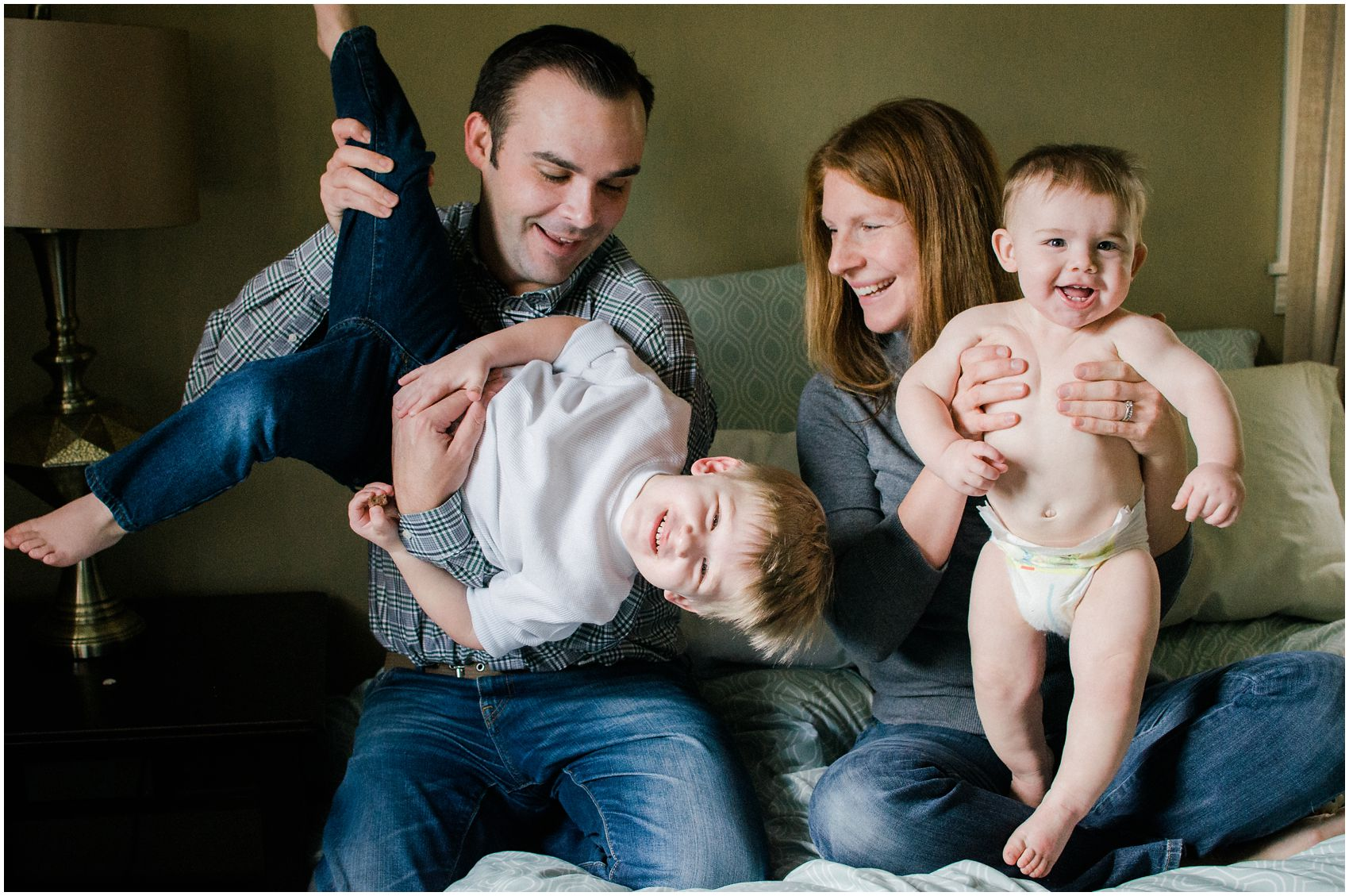 family photography of parents and two little kids at home