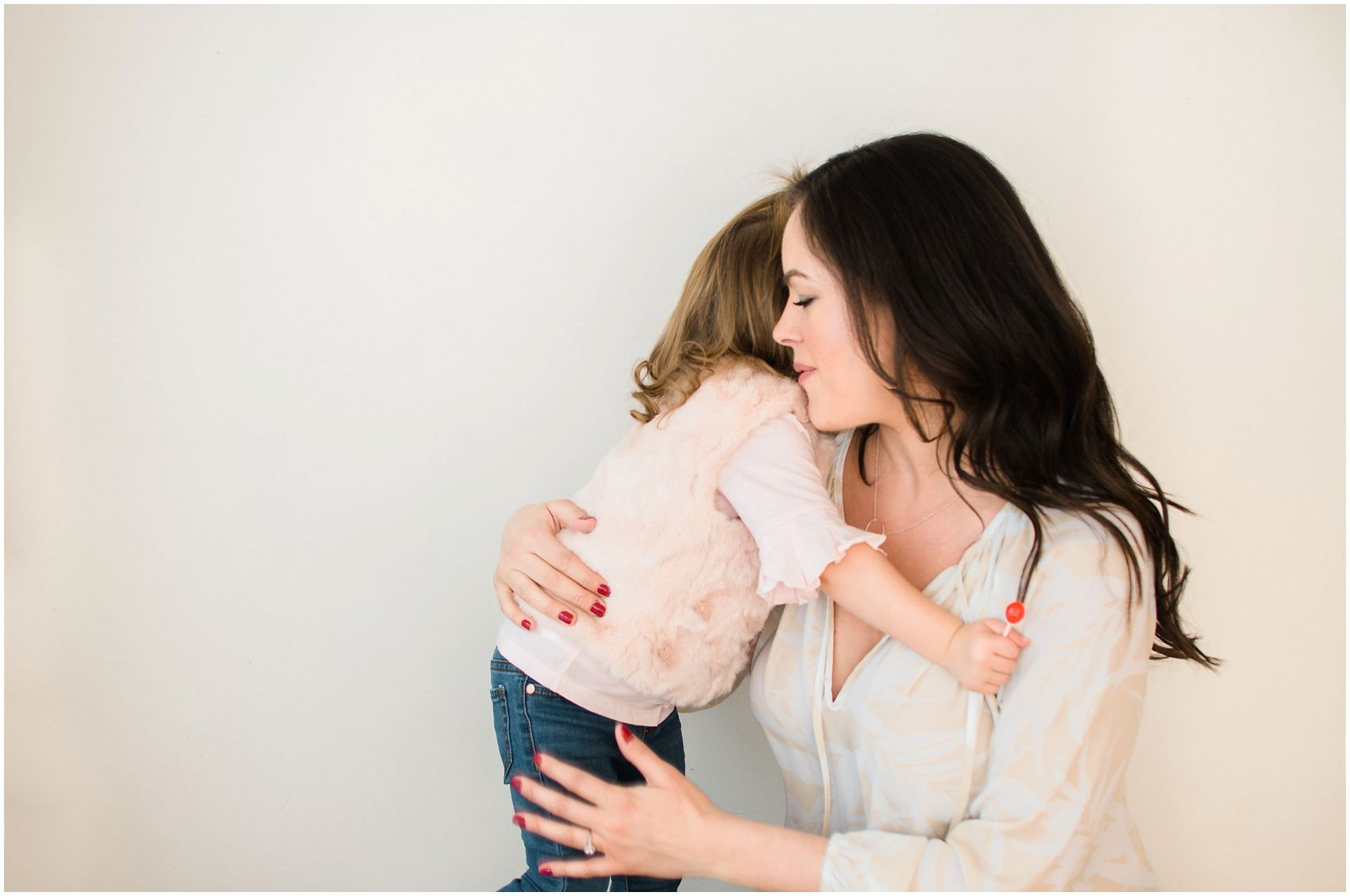 mommy hugging her little girl during Mommy and Me Photo Session