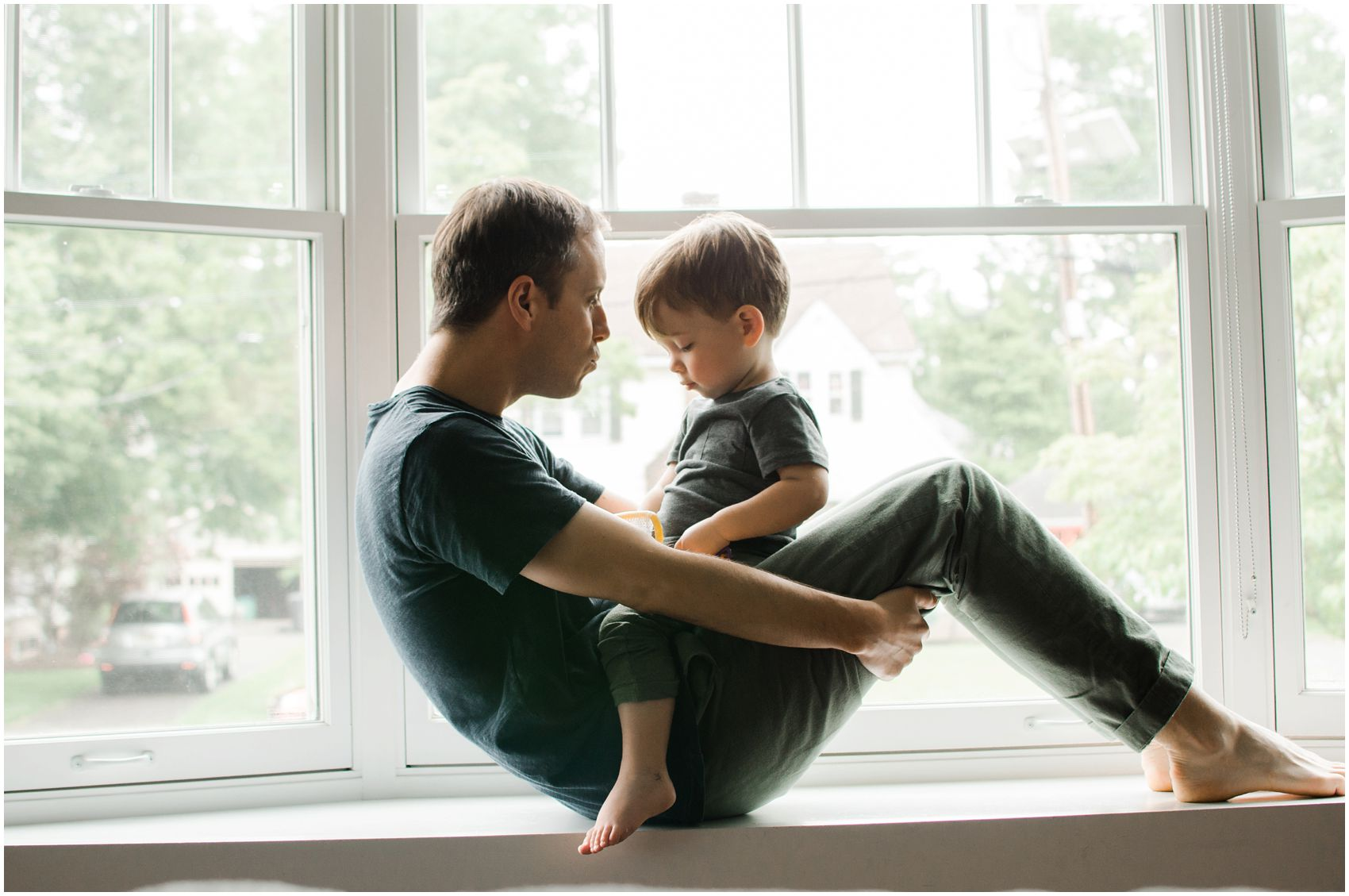 dad and son sitting by the window in New York