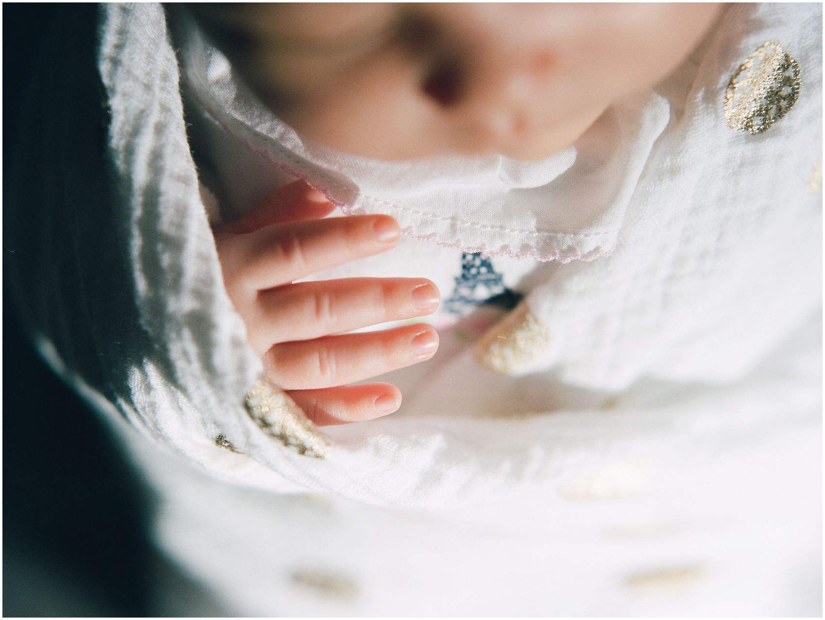 newborn photography of tiny baby fingers in a close up portrait