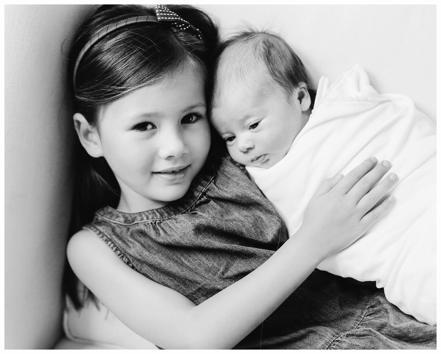a portrait of a baby girl and her older sister is the best gift for the mother and grandmother in NYC