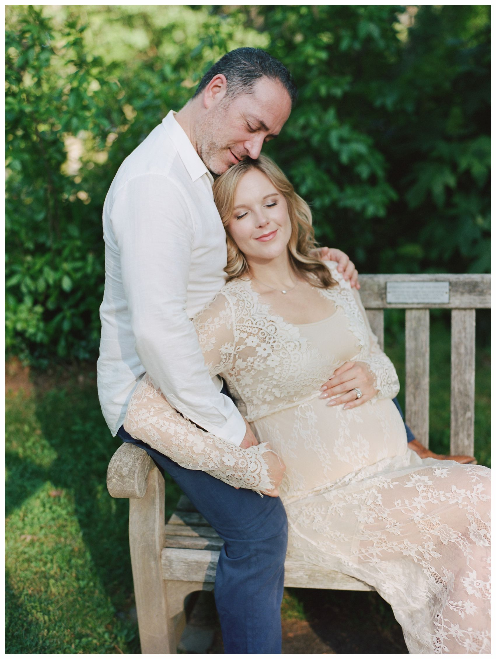 best time to do a maternity session is around 30 to 33 weeks as this couple sitting in the garden